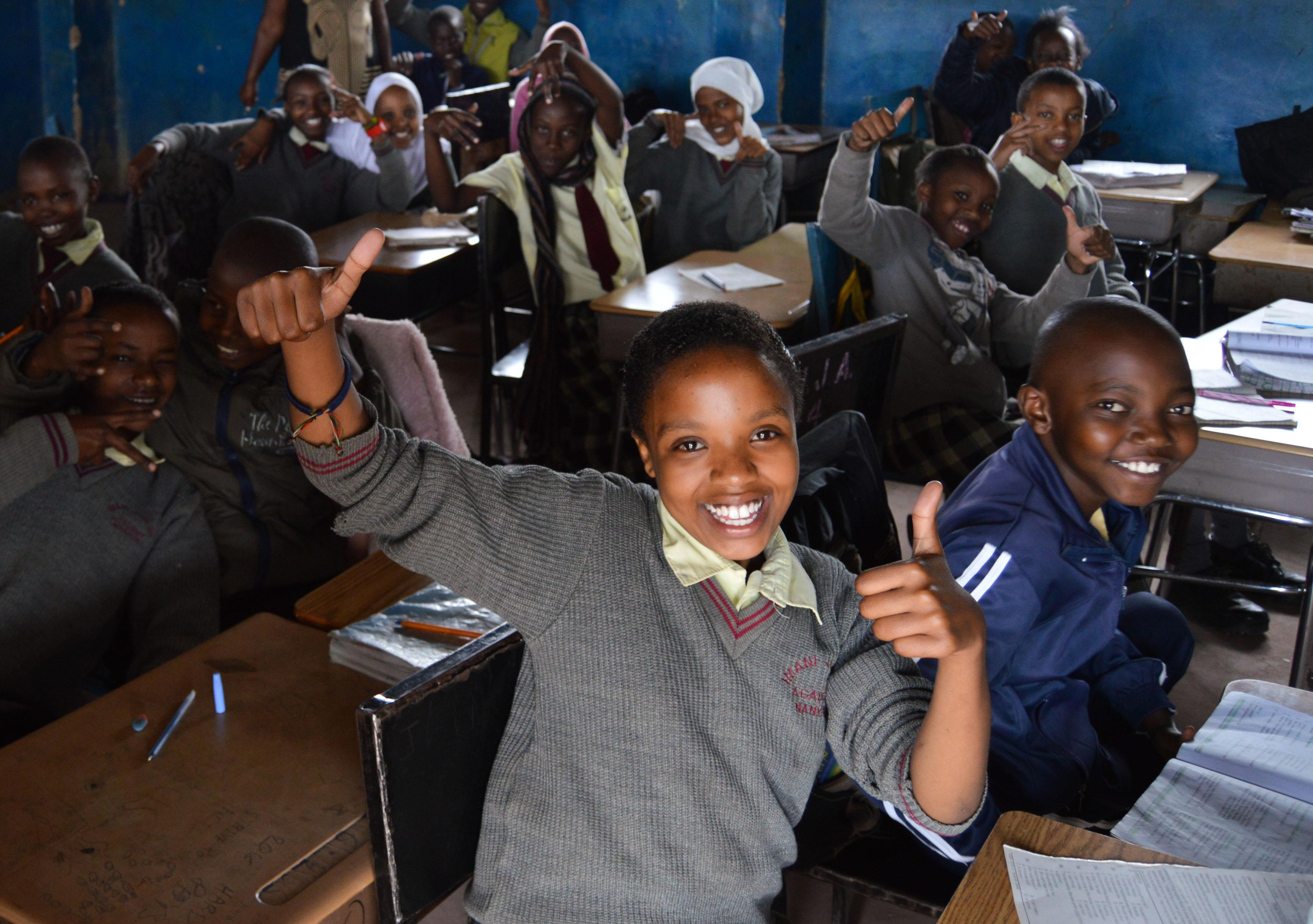 A student shares a thumbs up at one of our volunteer teaching placements in Kenya
